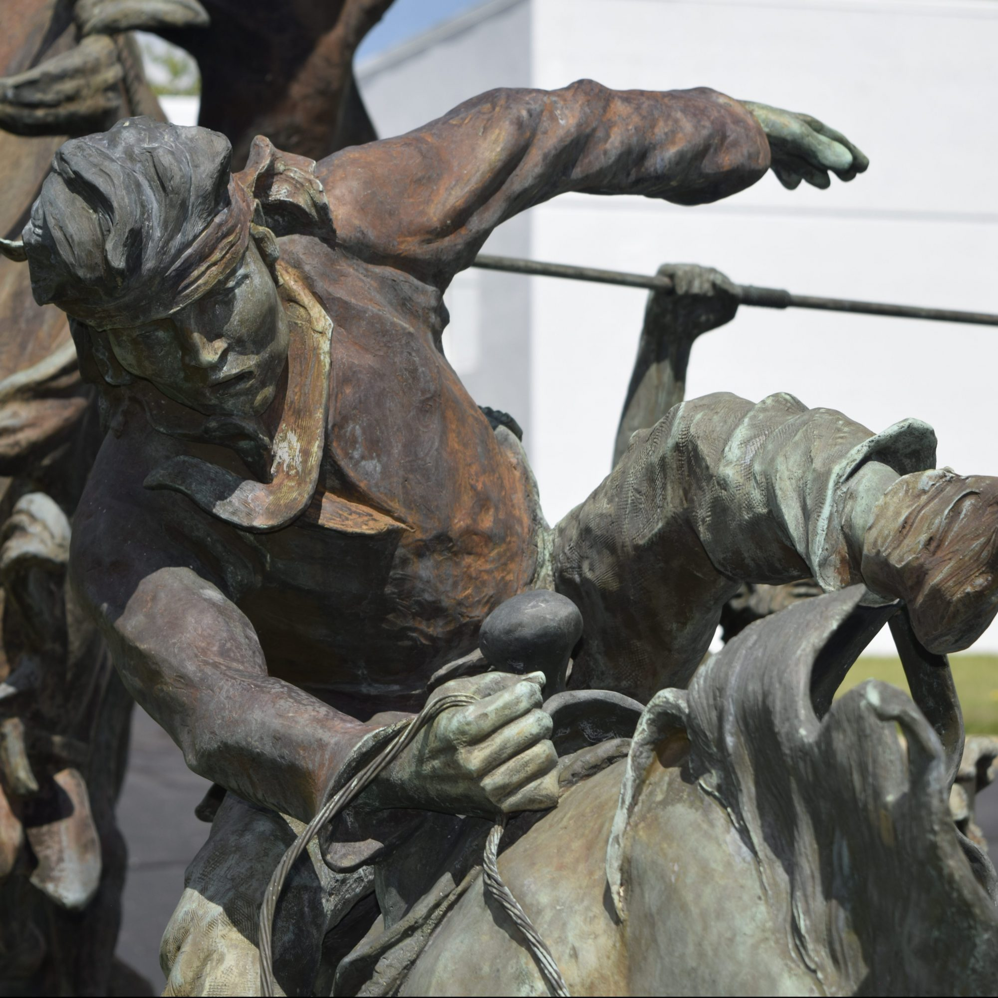 metal statue of man on horse